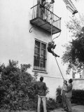 Men Sliding Down a Rope from their Balcony at the Dabney House
