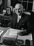 Pres Harry S Truman Seated at His Desk in the White House  Family Photographs on Table Behind Him