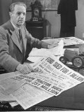 Harry Ferguson in His Office at His Desk with Collection of American Papers Clipps About His Suit