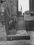 Englishmen Chatting as They Stand on Wapping Old Stairs Which Is a Great Thames Landmark