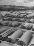 Aerial View of Quonset Huts Being Used for Storage and as Quarters for Military Personnel