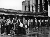 People Lining Up to Buy Tickets at the Railway Station