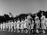 Director Oveta Culp Hobby Reviewing Wacs on Parade Ground