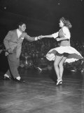 Couple Dancing in a Jitterbug Contest