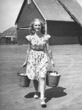 Francis Larson Collecting Eggs on Her Farm