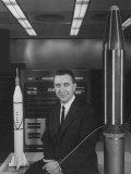 "Physicist James A Van Allen Sitting Between Models of Jupiter ""C"" Rocket and Explorer Satelliter"