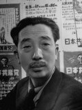 Portrait of Japanese Communist Sanzo Nozaka in Front of Wall of Party Posters