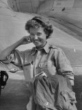 Correspondent Marguerite Higgins Smiling  Leaning Against Airplane