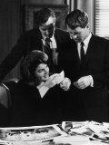 Ivan Chermayeff  Robert and Mrs John Kennedy Looking over Photos