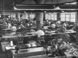 Men and Women Working in Clothing Factory