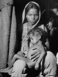 Indian Wife of a Tannery Worker Holding Her Child at Home in the Chawls