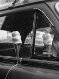 Ice Cream Cone Melting Outside Rolled Up Window of Air Conditioned Car