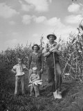 Farmer Carl Snider Standing with Family in Front of Cornfield