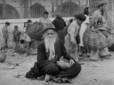 Elderly Jewish Man Sitting in Street after Surrender of City