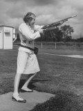 Pat Laursen  National Women's Skeet Shooting Champion  Taking Aim in Crouching Stance