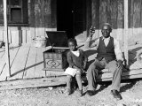Sharecropper  Lonnie Fair and Daughter Listen to Victrola on Farm in Mississippi
