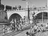 People Sunbathing and Swimming at the Tiber Boathouse