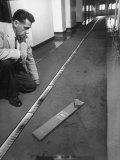 Solar Expert Robert S Richardson Studying Sun&#39;s Spectrum on 40-Ft Long Strip of Photographs