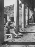 Workman Repairing One of the Fifty Bomb Damaged Spots in the Ruins of Pompei