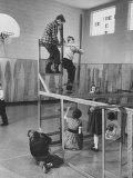 Children Playing on a Giant Erector Set