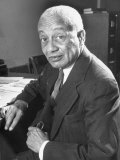 Portrait of Philosopher Alain Leroy Locke Sitting at Desk in Office at Howard University