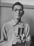 Japanese War Criminal Shumei Okawa Holding Buddhist Bible at His Arraignment
