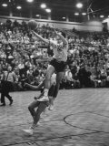 Basketball Player Tom Gola Leaping in the Air to Make a Shot During a Basketball Game