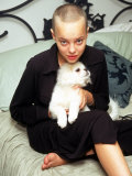 Model Actress Bijou Phillips  with Shaved Head  Holding Pet Dog