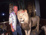 Designer Gianni Versace Beside Stuffed Lion at Sly Stalone's Home