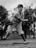 Boy Playing a Game of Little League Baseball