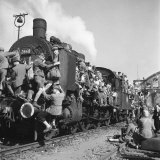 Post WWII German Refugees and Displaced Persons Crowding Every Square Inch of Train Leaving Berlin