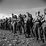 Group of Fairly Well Equipped Male and Female Resistance Fighters  Called the Andartes