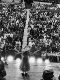Minnie Pearl Performing  Shot from Above and Behind with Engaged Audience  at Grand Ole Opry Show