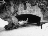 Men in an Army Jeep Pulling the Fighter Vampire Plane Out of the Proof Underground Hangar