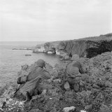 American Marines Searching Craggy Cliffs for Japanese Snipers and Island Civilians