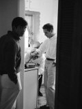 Actor Paul Newman Cooking Eggs for Guests Incl Anthony Perkins During an Informal Party