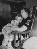 Den Mother Still in Uniform  Sleeping While Holding Her Daughter