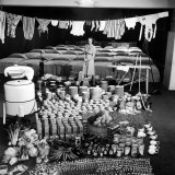 Housewife Marjorie McWeeney with Broom Amidst Display of Her Week's Housework  Bloomingdale's Store
