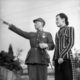 Generalissimo Chiang Kai-Shek Pointing Something Out to His Wife
