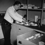 Servant Aboard the Atlantic Clipper Preparing Dessert Plates for the Passengers Aboard