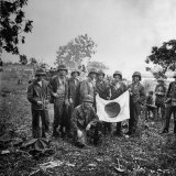 US Marines Holding Japanese Flag Captured During First Days of the Saipan Offensive