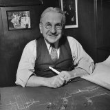 Albert Kahn Sitting at a Desk with Blueprints