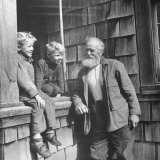 Old Man Talking to Two Young Boys