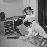 Former Nancy Oakes  Mrs Alfred Marigny Listening to Records with Her Puppy