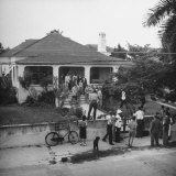 Jurors and Lawyers Standing on the Porch and Lawn of Alfred Marigny's Home