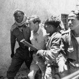 Arab Soldiers Escorting Jewish Prisoner to Arab Legion Headquarters