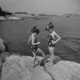 Two Little Girls Modelling Sun Dot Bathing Suits While Playing on the Rocks