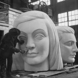 Heads of Figures Weigh About 600 Pounds Each