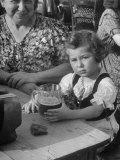 Small Girl Enjoying a Stein of Weak Beer