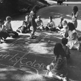 Girls and Boys Playing Hopscotch
